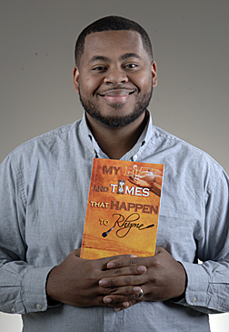 "Derrick Hamilton with his poetry book, ""My Life and Times That Happen to Rhyme"""