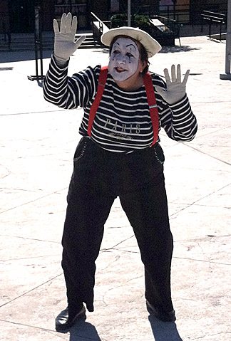 "As part of ""The 52/52 Project,"" Sherry Stanfa-Stanley performed as a mime in front of a Kentucky shopping center."