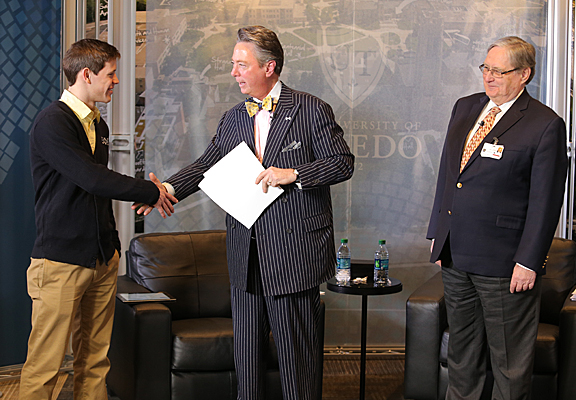 UT senior Drew O'Donnel was congratulated by Lawrence J. Burns, vice president for external affairs, center, and University President Lloyd Jacobs for being named UT's Jefferson Award honoree for October.