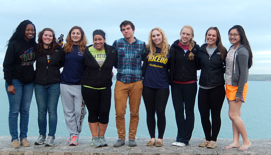UT students studying at the University of Salford posed for a photo on the wall at the Dale Fort Field Center on the Irish Sea, Pembrokeshire Coast, Wales. They are, from left, Rose Henry, Rebekka Henck, Susan Salari, Maria Paulett, Nathan Wagner, Rebekah Skerl, Courtney Rusch, Tayler Fisher-Grabowsky and Ashley Teow.