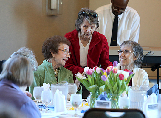 Satellites Auxiliary members and MCO retirees Jean Brenner, left, Rose Tammerine, center, and Carolyn Stone chatted at the luncheon held during National Volunteer Week.
