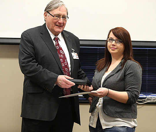 UT President Lloyd Jacobs presented Hannah Konnagan with one of the University's monthly Jefferson Awards.