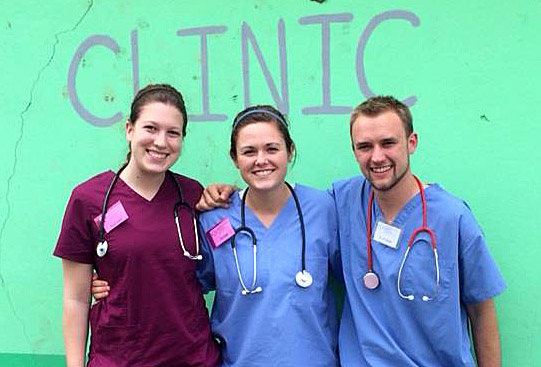 Hannah Kissel, Anna Crisp and Brandon Stewart posed for a photo in Belize last month for an 12-day medical mission.