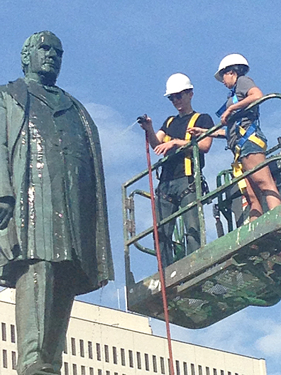 Conor Roberts, a fifth-year sculpture and 3-D art major, manned the hose and Brandi White, a third-year criminal justice major who is switching to be an art major, assisted with the restoration of the statue of President William McKinley in front of the Lucas County Courthouse in Toledo.