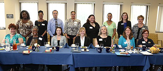 Participants who attended a regional women's center meeting held on Main Campus posed for a photo.