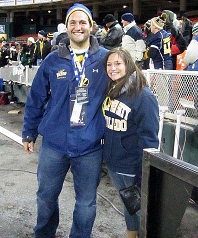 "UT graduates Matt Rubin and Bre Democko, shown here at the 2011 Military Bowl, will showcase their search for a home on HGTV's ""House Hunters,"" which will air Tuesday, July 22, at 10 p.m."