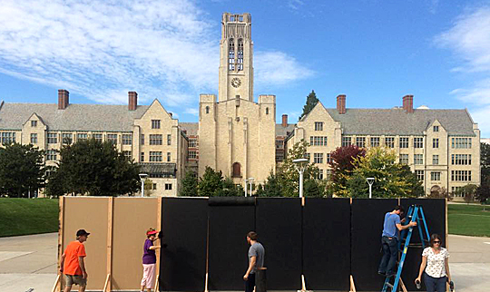 Members of the UT German Club built their own version of the Berlin Wall on Centennial Mall.