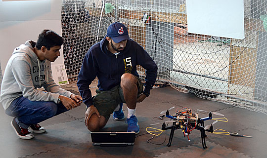 Mohammad Sarim, left, and Alireza Nemati readied the unmanned aerial vehicle for a flight.