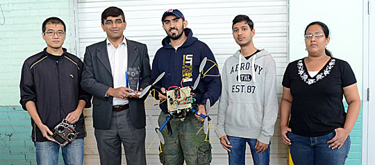 Members of the UT Smart Unmanned Aerial Vehicle for Exploration Team, from left, Jisheng Li, Dr. Manish Kumar, Alireza Nemati, Mohammad Sarim, and Padmapriya Sampathkumar, posed for a photo with their award.