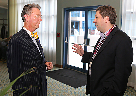 Lawrence J. Burns, UT vice president for external affairs, left, talked with Brian Balasia, co-founder and CEO of Digerati, last week during a break at the uHeart Digital Media Conference.