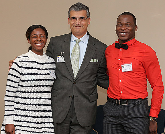 Dr. Imran Ali, professor of neurology and senior associate dean for academic affairs, joined students Ariel Sims and Olatoye Olutola at the College of Medicine and Life Sciences Scholarship Dinner Oct. 2.