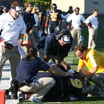 In this 2011 photo, Dr. Roger Kruse, right, tended to an injured player.