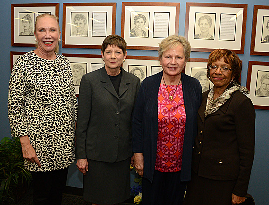 Posing for a photo in the LaValley Law Library were, from left, Lucas County Prosecutor Julia Bates, Assistant U.S. Attorney Holly Taft Sydlow, who are both graduates of the UT College of Law, and former Ohio Supreme Court Justice Alice Robie Resnick and United States Magistrate Judge Vernelis Armstrong. Their portraits are included on the second floor of the library as part of the Toledo Women Lawyers History Project.