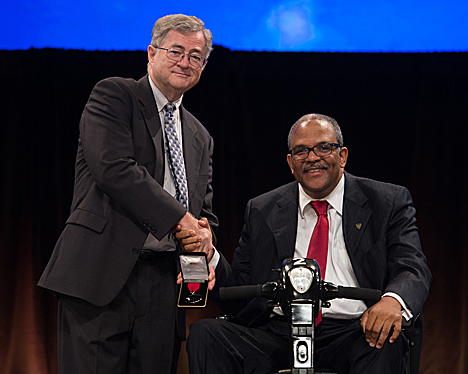 Dr. Reginald Baugh, right, received a presidential citation from Dr. Richard Waguespack, who was president of the American Academy of Otolaryngology — Head and Neck Surgery at the annual meeting in September. This photo is copyright 2014 by the American Academy of Otolaryngology-Head and Neck Surgery Foundation.
