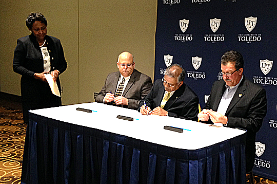 At the ceremonial signing were, from left Jovita Thomas-Williams, UT associate vice president for human resources and talent development; Randy Desposito, president of AFSCME Local 2415; Dr. Nagi Naganathan, UT interim president; and Steve Kowalik, regional director of AFSCME Council 8.
