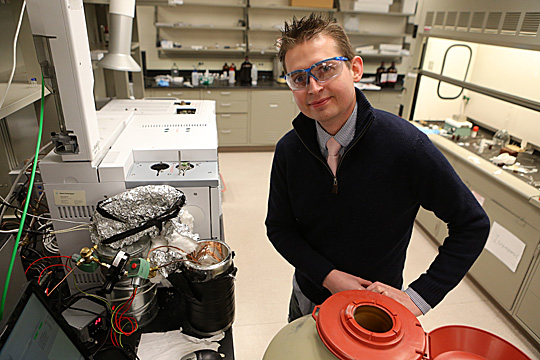 Dr. Jared Anderson just poured liquid nitrogen into a dewar that is the cryogenic cooling unit for a two-dimensional gas chromatograph. This separation system allows him to obtain profiles of paraffins and aromatic compounds that are components of petrochemical samples, such as kerosene and diesel fuels.