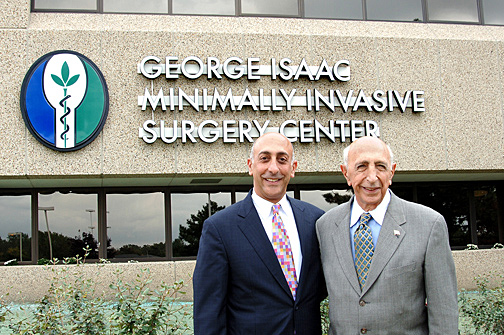 George Isaac and his son, Zac, posed for a photo in 2006 when the George Isaac Minimally Invasive Surgery Center was dedicated at UT Medical Center.