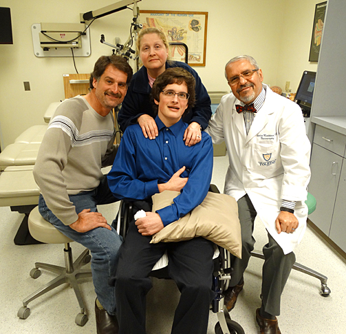 Nicholas Kuns, center, posed for a photo with his parents, Brian and Tammy Kuns, and Dr. Azedine Medhkour.