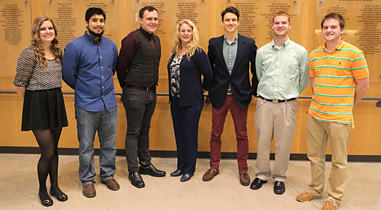 Laura Williams, center, UT senior lecturer in management, posed for a photo with some students who are involved with the Free Tax Preparation Program, from left, Marissa Gibbons, Max Sanchez, Austin Morrin, Evan Madden, Parker Wall and Derek Martindale.