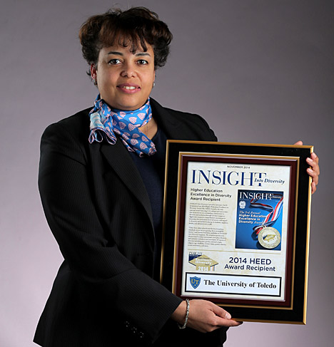 Dr. Shanda Gore, associate vice president for equity, diversity and community engagement, and chief diversity officer, shows off the 2014 Higher Education Excellence in Diversity Award from INSIGHT Into Diversity magazine that she accepted recently in Washington, D.C., on behalf of the University.