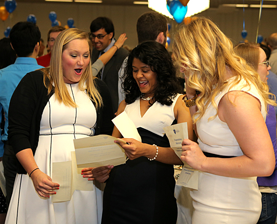 Sonya Naganathan, center, showed her residency placement letter to Chelsea McKirnam, left, and Marla Scott at Match Day. Naganathan will study emergency medicine at Barnes-Jewish Hospital in St. Louis, and McKirnam and Scott will train in obstetrics and gynecology at the University of Kentucky Medical Center in Lexington and Johns Hopkins Hospital in Baltimore, respectively.