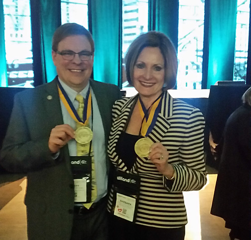 Brett Loney and Barbara Tartaglia-Poure display their Advanced Certified Fundraising Executive medals.