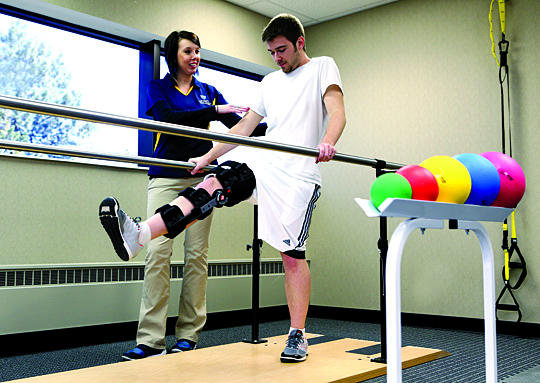 Physical Therapist Marci Cancic worked with a patient at UT Health's new physical therapy office at the Regency Medical Campus. A grand opening for UT Health Physical Therapy and Sports Medicine at Regency will be held Friday, April 10.