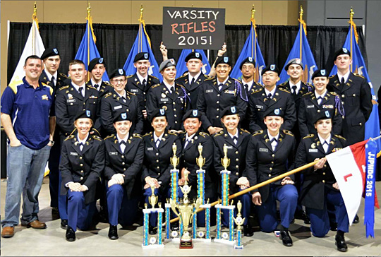 The UT Pershing Rifles Troop L-1 showed off the championship cup and trophies it won at the recent John J. Pershing Memorial Drill Competition.