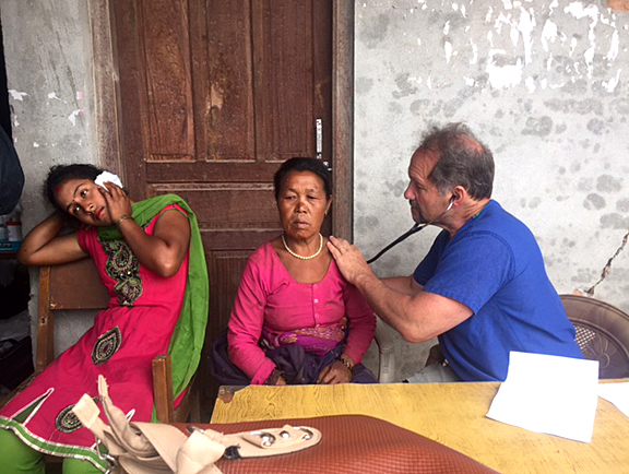 Dr. Kris Brickman examined a woman in Nepal. He and two UT residents went to the country following the first earthquake to provide medical assistance.