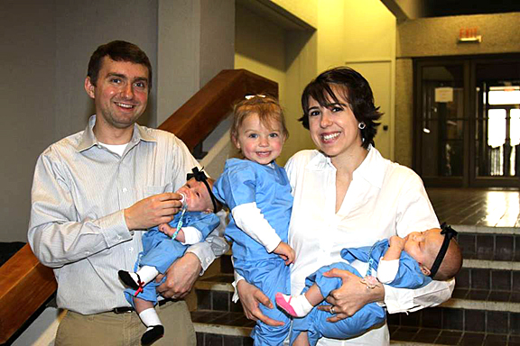 Chris Johnson holds Madelyn, and his wife, Jillian, has Claire, left, and Sophia. Chris will receive the doctor of medicine degree Friday, May 29, and then study ophthalmology at Indiana University Health Ball Memorial for a year before serving his residency at Loyola University Hines VA Hospital in Chicago.