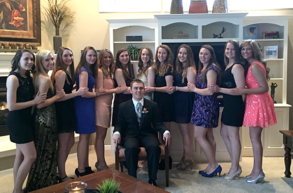 Thomas Huffman posed for a photo with some of his dates for the prom, from left, Alpha Xi Delta members Sydney Miller, Kirsten Zalewski, Becca Potts, Maddie Burke, Gabbi Radford, Sydney Helsinger, Liz Russell, Jenn Lohrman, Courtney Howe, Broghan Gasser, Megan Graber and Corinne Porter.