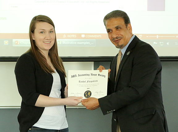 Dr. Hassan HassabElnaby, professor and chair of the Accounting Department, presented an honor society certificate to Rachel Fitzpatrick.