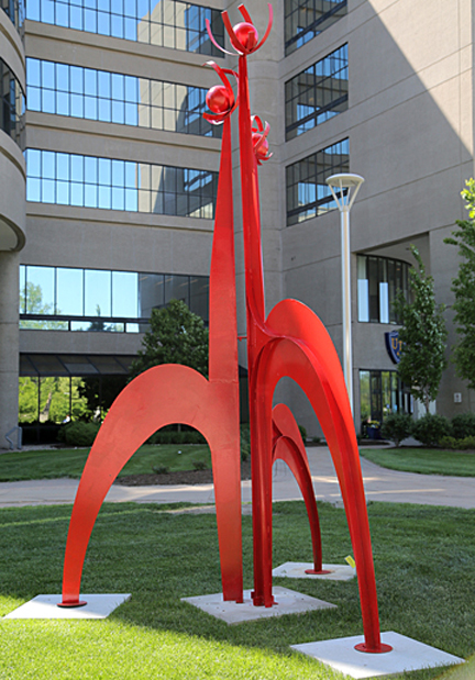 """Promise to Flower"" by Ric Leichliter is placed between UT Medical Center and Mulford Library."