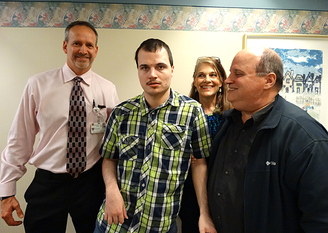 Dr. Daniel Gaudin, left, posed for a photo with the Walters, from left, Sam, Mary and Kirk, during a checkup in April.
