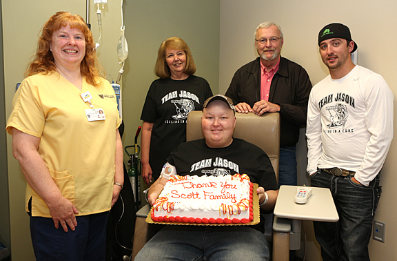 Jason Scott, seated, celebrated his last day of chemotherapy at the Eleanor N. Dana Cancer Center with a cake to share with, from left, Cindy Peters, staff nurse; mother, Vicki; dad, Dan; and friend, Max Newcomer.