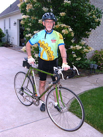 "Dr. David Weldy sports a jersey that features Rotary International's symbol, the cog, and says ""service above self,"" which is one of the organization's themes. He will ride with bicyclists from Rotary International to raise funds for Medical Equipment and Supplies Abroad."