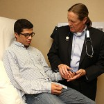 Dr. Jeffrey Hammersley asked Benjie Benitez how his hands were doing during a visit to UT Medical Center earlier this month. The Honduran teen was diagnosed with a rare mitochondrial disease that leads to muscle breakdown.