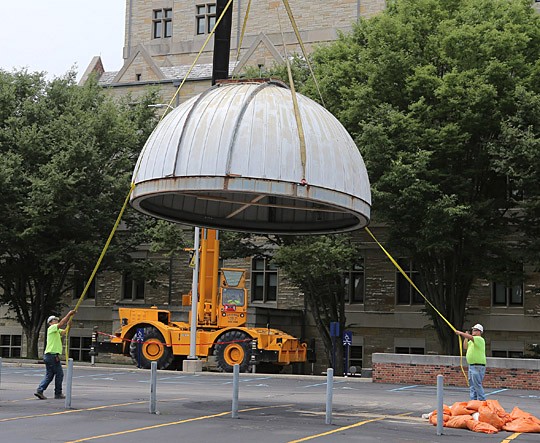 A crane removed the dome of the Brooks Observatory last week and workers helped guide the structure to the ground.