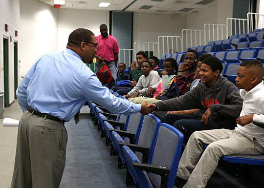 Demond Pryor, director of the Office of Recreation and vice chair of mentoring with Brothers on the Rise, shook hands with Deon Brown, a sixth-grader at Bennett Venture Academy, last month when students from the Toledo school visited campus.