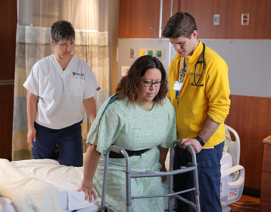 Tori Smith, physical therapist, and Spencer Wotring, nurse, helped a patient last week.
