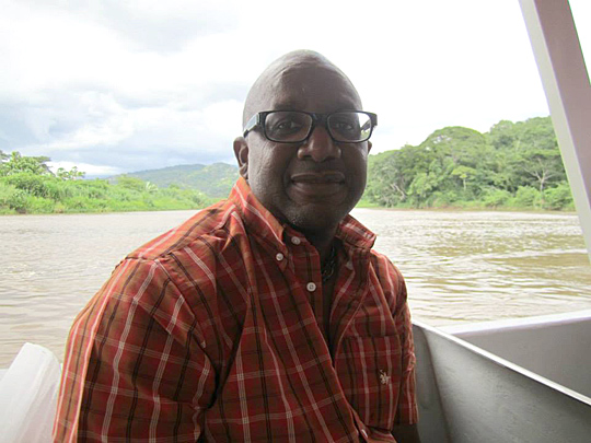 Dr. Ainsworth Bailey, shown here on a river safari during his first trip to Costa Rica in 2013, will return to Heredia to teach.