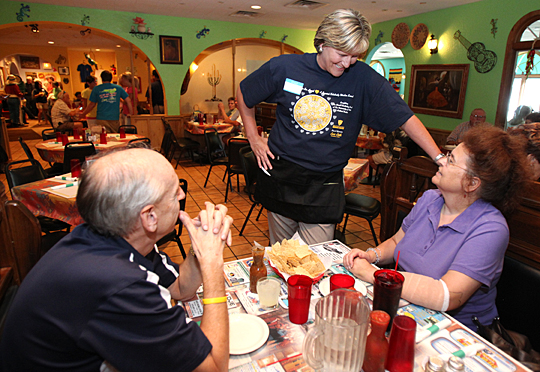 Women's Basketball Coach Tricia Cullop talked to customers at last year's Celebrity Wait Night at Loma Linda.