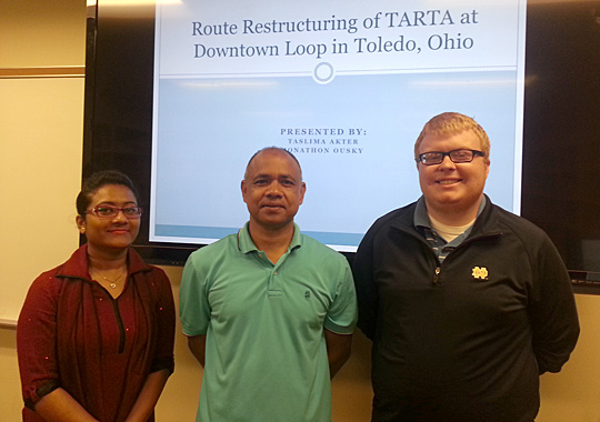 Dr. Bhuiyan Alam, associate professor of geography and planning, center, posed for a photo with graduate students Taslima Akter and Jonathon Ousky, who put together new route proposals for TARTA for the Community Planning Workshop class.