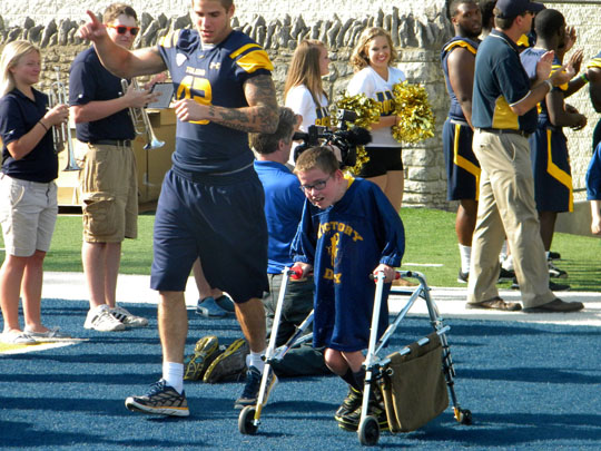 A student was celebrated in the end zone during last year's Victory Day.