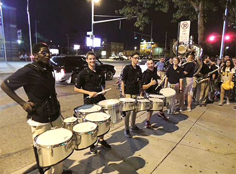 Members of the UT Marching Band and the UT cheerleaders went downtown last week for pop-up pep rallies.