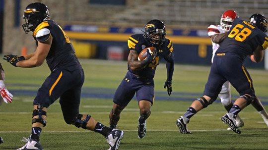 Running back Damion Jones-Moore ran 11 yards for a touchdown in Toledo's big victory over Arkansas.