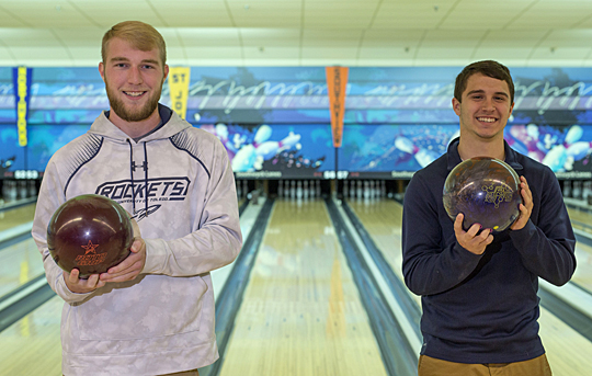 "Ryan Brown, left, and Jake Garfield, members of the Pharmacy Ambassadors & Pre-Professional Organization, are hosting a ""Strike Out Cancer"" bowling tournament Friday, Oct. 23, to raise money for the Eleanor N. Dana Cancer Center."