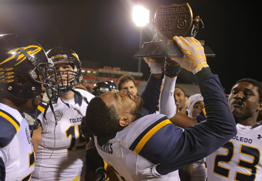 Senior cornerback Cheatham Norrils, who caught two interceptions during the game, hoisted the Battle of I-75 Trophy as the Rockets celebrated their big win.