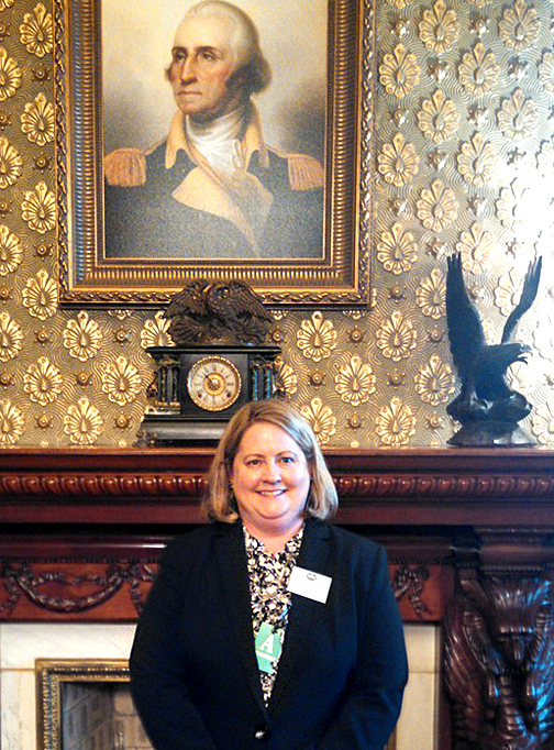 Dr. Beth Schlemper posed for a photo in the Eisenhower Executive Office Building, which is next to the White House.
