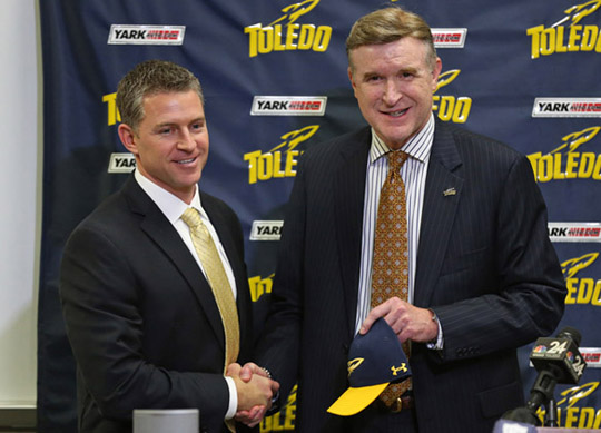 UT Vice President and Athletic Director Mike O'Brien, right, shook hands with Jason Candle after he was announced as the new head football coach at a Dec. 2 press conference.